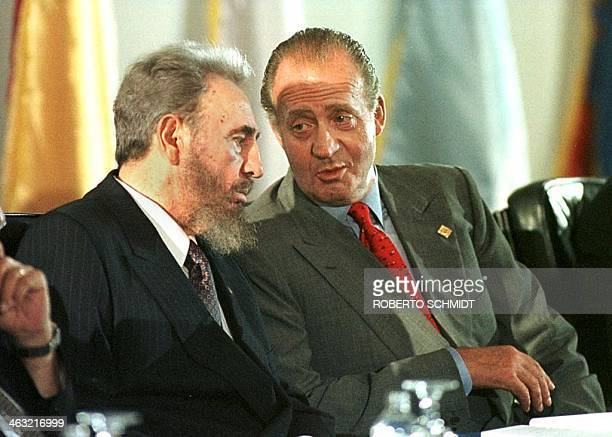 King Juan Carlos I of Spain speaks with Cuban President Fidel Castro during the opening ceremony of the VII IberoAmerican summit in Margarita Island...