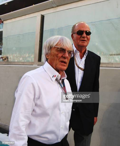 King Juan Carlos of Spain and Bernie Ecclestone are seen on the grid before the Abu Dhabi Formula One Grand Prix at the Yas Marina Circuit on...