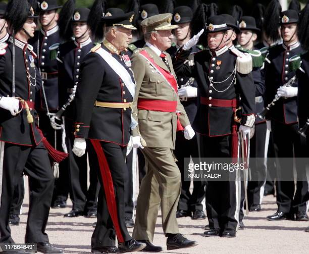 King Juan Carlos of Spain and King Harald of Norway inspect the Guard of Honour at the official welcoming ceremony at the Royal Palace in Oslo 06...