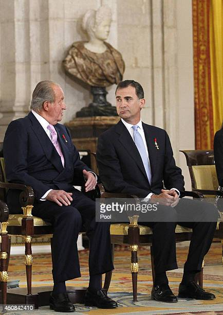 King Juan Carlos of Spain and Prince Felipe of Spain attend the official abdication ceremony at the Royal Palace on June 18 2014 in Madrid Spain King...