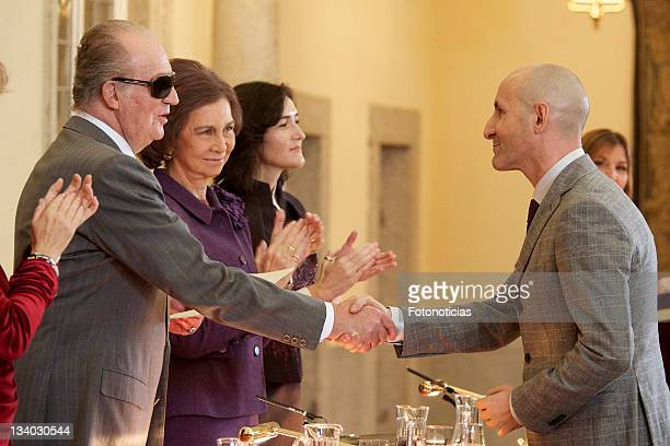 King Juan Carlos of Spain and Queen Sofia of Spain deliver a 'Gold Medal of Merit in Fine Arts' to Modesto Lomba at El Pardo Palace on November 24...