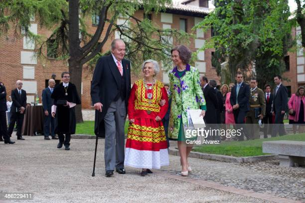 King Juan Carlos of Spain and Queen Sofia of Spain walk with the Cervantes Award 2013 winner Mexican author Elena Poniatowska for a family picture...