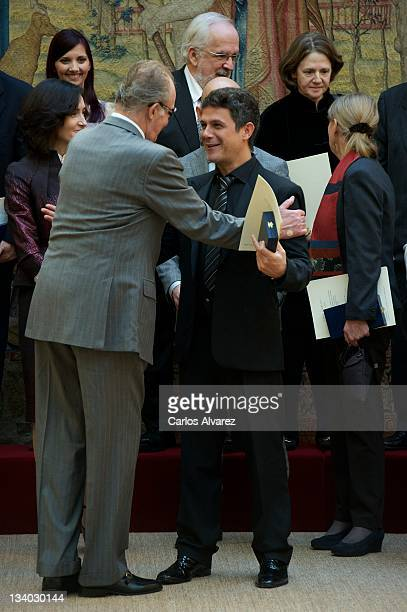 King Juan Carlos of Spain and Spanish singer Alejandro Sanz attend Gold Medals of Merit in Fine Arts 2010 ceremony at the El Pardo Palace on November...