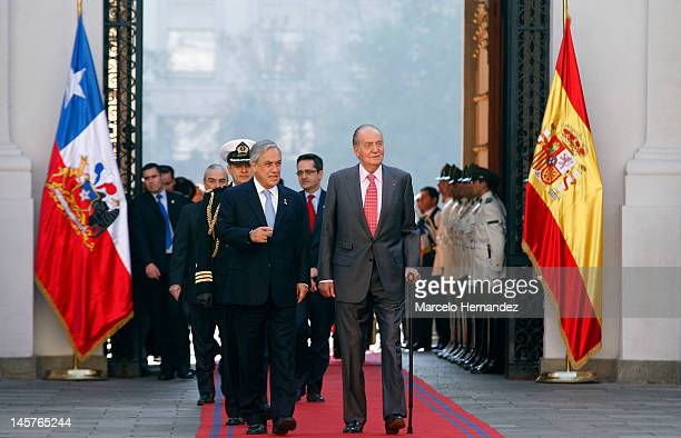 King Juan Carlos of Spain and the President of Chile Sebastián Piñera walk into the Presidential Palace La Moneda on June 5 2012 in Santiago Chile