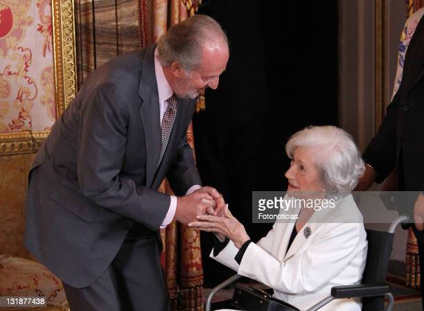 King Juan Carlos of Spain and writer Ana Maria Matute attend a lunch in ocassion of the '2011 Cervantes Award' at The Royal Palace on April 26, 2011...