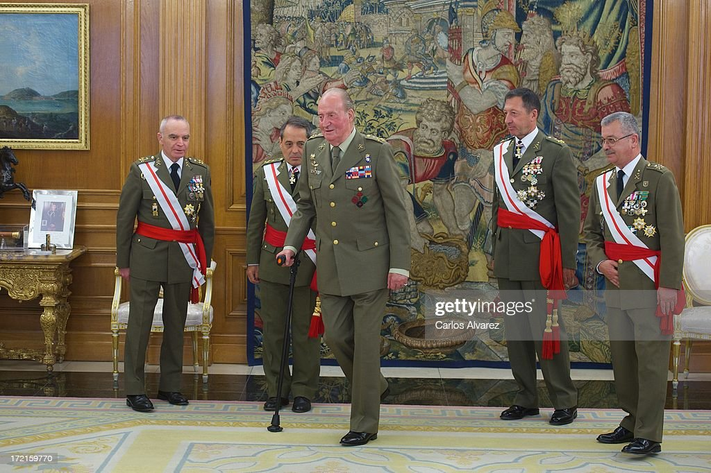 King Juan Carlos of Spain (C) attends several audiences at Zarzuela Palace on July 2, 2013 in Madrid, Spain.