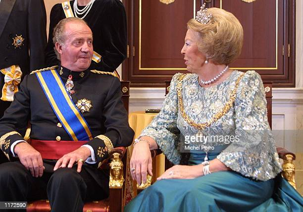 King Juan Carlos of Spain chats with Dutch Queen Beatrix October 23 2001 prior to a state banquet in Amsterdam The Netherlands The Spanish King and...