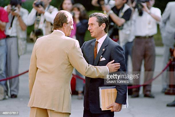 King Juan Carlos of Spain confers with Brazilian President Fernando Collor de Mello at the Spanish Senate on July 24 before the start of the second...