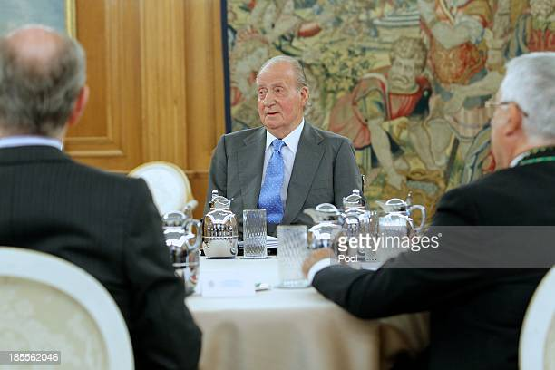 King Juan Carlos of Spain meets Governing Board of the Institute of Spain at the Zarzuela Palace on October 22 2013 in Madrid Spain