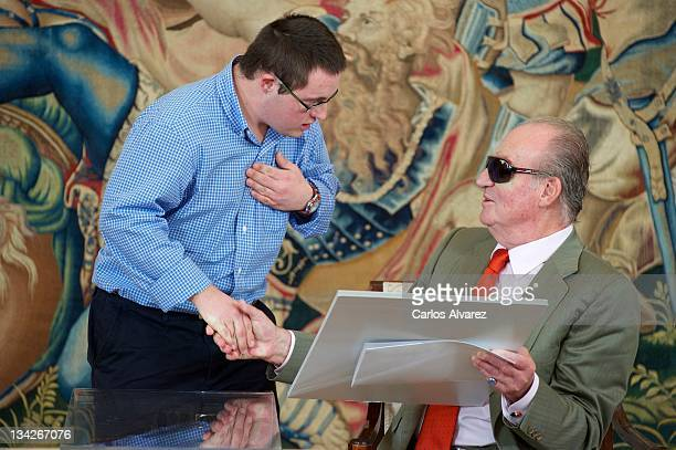 King Juan Carlos of Spain meets winners of the 'What is a King For You' competition at Zarzuela Palace on November 29 2011 in Madrid Spain