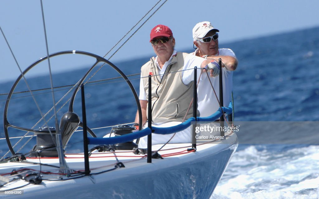 King Juan Carlos of Spain (L) on board of 'Bribon' during the 28th Copa del Rey Mapfre Audi Sailing Cup on August 4, 2009 in Mallorca, Spain.