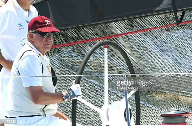 King Juan Carlos of Spain on board of the Bribon attends the first day of 21st Sailing Trophy Copa del Rey July 29 2002 in Palma de Mallorca Spain