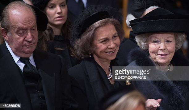 King Juan Carlos of Spain Queen Sofia of Spain and Dutch Princess Beatrix attend the funeral ceremony of Queen Fabiola at the Saint Michael and St...