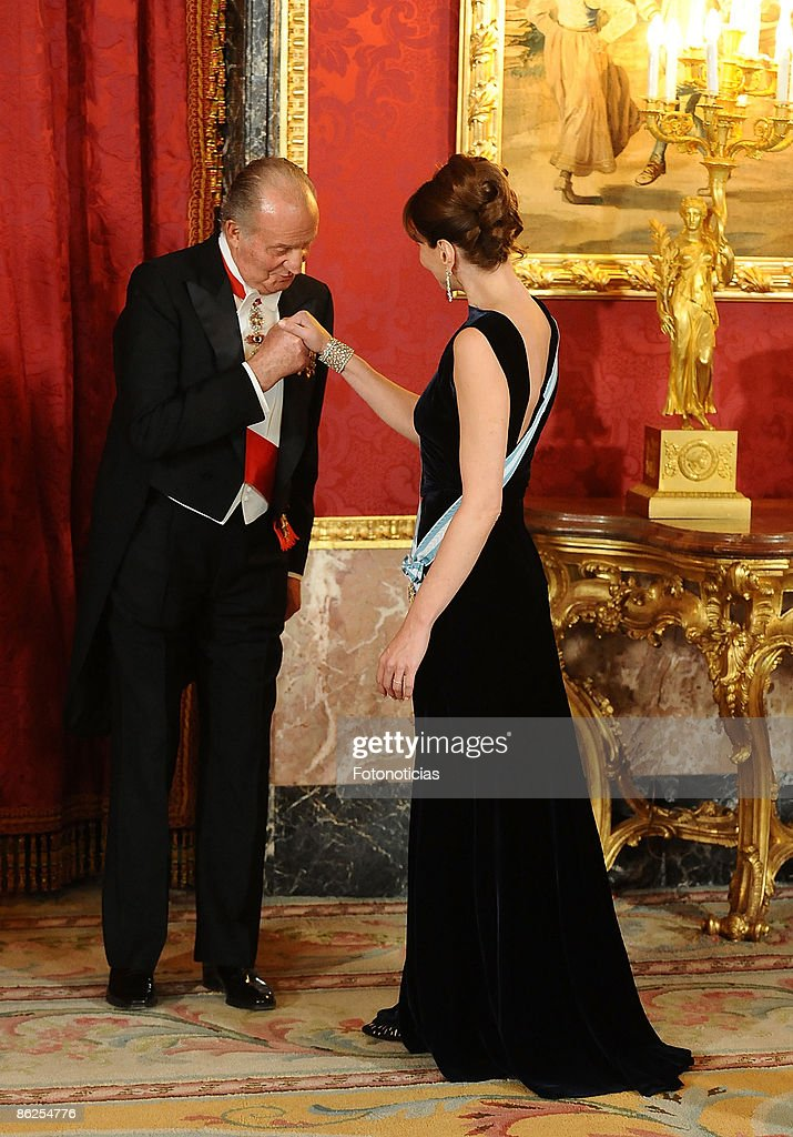 King Juan Carlos of Spain receives Carla Bruni Sarkozy at the Gala Dinner honouring French President Nicolas Sarkozy, at The Royal Palace, on April 27, 2009 in Madrid, Spain.