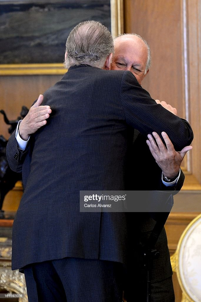 King Juan Carlos of Spain (L) receives former Chilean President Ricardo Lagos (R) at Zarzuela Palace on February 12, 2013 in Madrid, Spain.