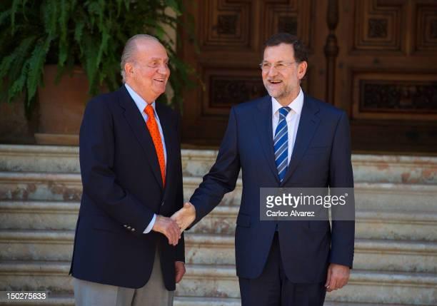 King Juan Carlos of Spain receives Spanish President Mariano Rajoy at Marivent Palace on August 14 2012 in Palma de Mallorca Spain