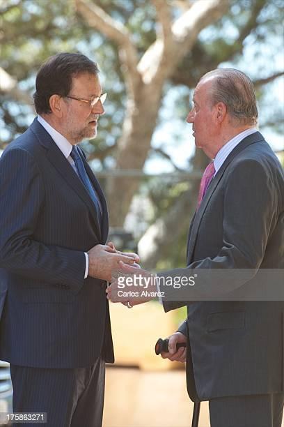 King Juan Carlos of Spain receives Spanish President Mariano Rajoy at Marivent Palace on August 9, 2013 in Palma de Mallorca, Spain.