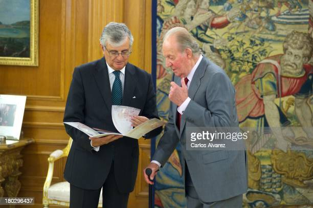 King Juan Carlos of Spain receives State Attorney General Eduardo Torres Dulce at the Zarzuela Palace on September 11 2013 in Madrid Spain