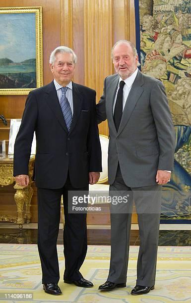 King Juan Carlos of Spain receives writer and Nobel Prize winner Mario Vargas Llosa at Zarzuela Palace on May 11 2011 in Madrid Spain