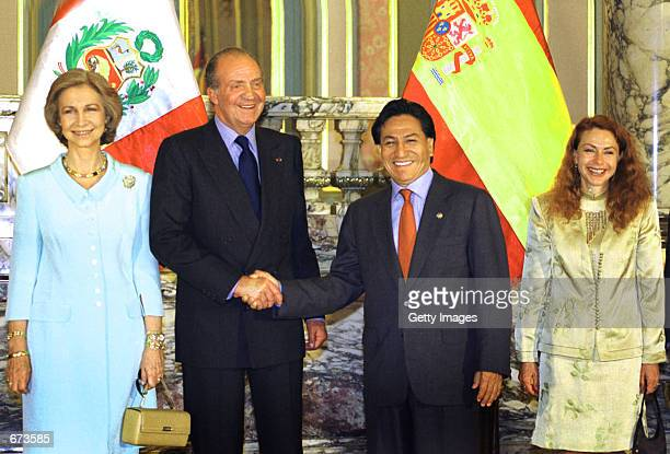 King Juan Carlos of Spain shakes hands with Peruvian President Alejandro Toledo accompanied by Queen Sofia and Peruvian first lady Eliane Karp during...