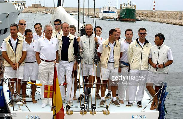 King Juan Carlos of Spain stands with his sailing team on board of 'Bribon' during the second day of the IV Sailing Trophy Queen Sofia July 06 2002...