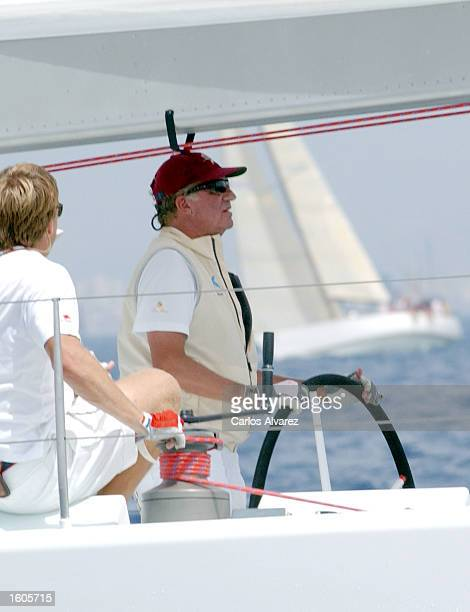 King Juan Carlos of Spain steers a yacht during the first day of the 20th Copa del Rey regatta July 31 2001 at Palma de Mallorca Island Spain