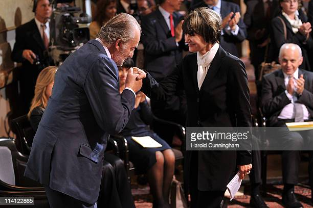 King Juan Carlos of Spain thanks Swiss President Micheline CalmyRey for her speech by kissing her hand as the Swiss delegation and the Spanish...