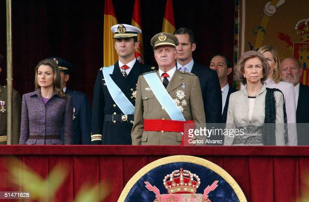 King Juan Carlos, Queen Sofia, Crown Prince Felipe and Princess Letizia of the Spanish Royal Family attend the National Day Military Parade at the...