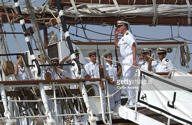 King Juan Carlos reviews sailors on the Spanish military training ship Juan Sebastian Elcano July 29 2001 at Palma de Mallorca Island Spain