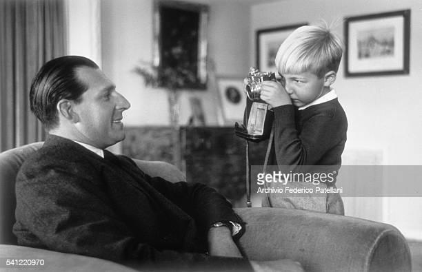King Juan Carlos Teresa Silverio Alfonso de Borbon y Battenberg is photographed by his young son Alfonso
