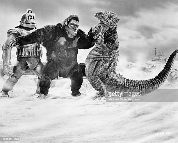 King Kong fights off his robot counterpart and a dinosaur in a scene from the film 'King Kong Escapes' 1967