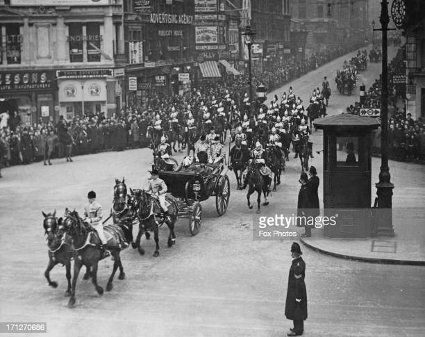 King Leopold III of Belgium accompanied by the Duke of Kent drives through Ludgate Circus to receive and address from the Corporation London 17th...