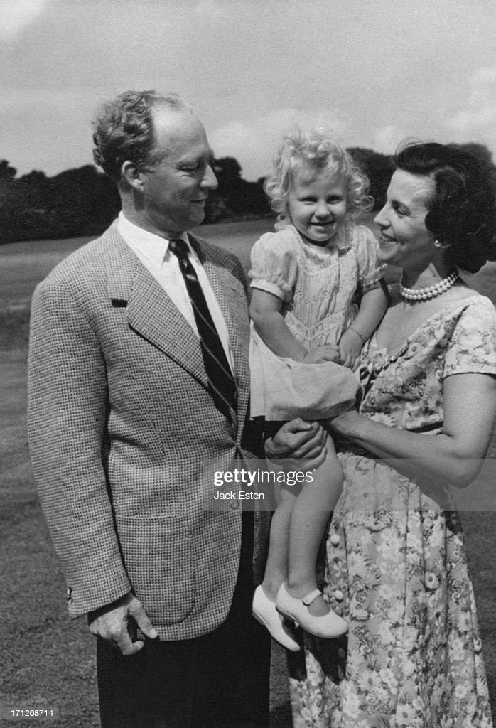 King Leopold III of Belgium (1901 - 1983) and Princess Lilian of Belgium (1916 - 2002) with their daughter Princess Marie-Christine of Belgium, in the grounds of the Royal Palace of Laeken, Brussels, circa 1954.