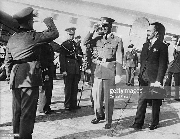 King Leopold III of Belgium is greeted on his arrival as he returns to Brussels from exile in Swizerland where he has spent the last six years 22nd...