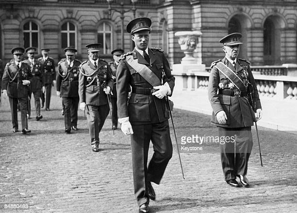 King Leopold III of Belgium leaves the royal palace in Brussels with his staff for a military review 4th May 1937 The review had been postponed twice...