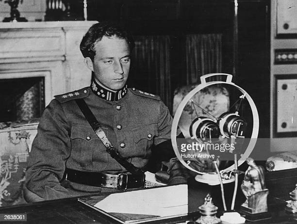 King Leopold III of Belgium making a broadcast speech at the microphone possibly close to the time of the invasion of Belgium