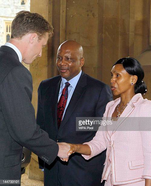 King Letsie III of Lesotho and Queen Mesenate Mohato Seeiso are greeted by a member of household staff as they arrive at a lunch For Sovereign...