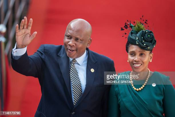 King Letsie III of Lesotho gestures while arriving at the Loftus Versfeld Stadium in Pretoria South Africa with his spouse for the inauguration of...