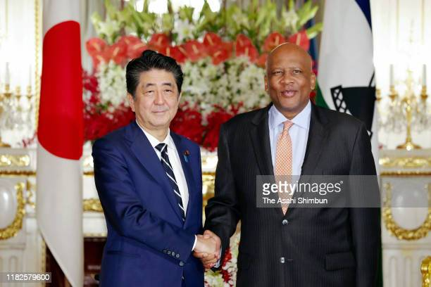 King Letsie III of Lesotho shakes hands with Japanese Prime Minister Shinzo Abe prior to their meeting at the Akasaka State Guest House on October...