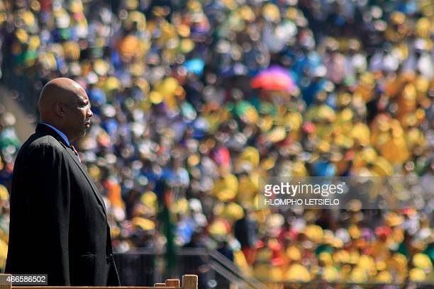 King Letsie III of Lesotho watches a parade on March 17, 2015 during the inauguration ceremony of the new prime minister in Maseru. AFP PHOTO /...