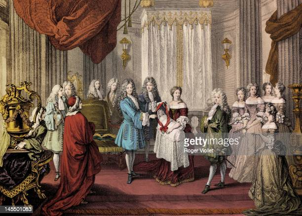 King Louis XIV of France king of France presenting the red ribbon of the Order of Saint Louis to the Duke of Burgundy circa 1682 Engraving by...