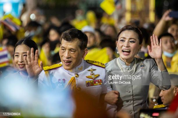King Maha Vajiralongkorn and Queen Suthida greet supporters of the Thai monarchy outside the Grand Royal Palace on November 1, 2020 in Bangkok,...