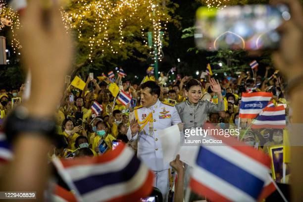 King Maha Vajiralongkorn and Queen Suthida greet supporters of the Thai monarchy outside the Grand Royal Palace on November 1, 2020 in Bangkok,...
