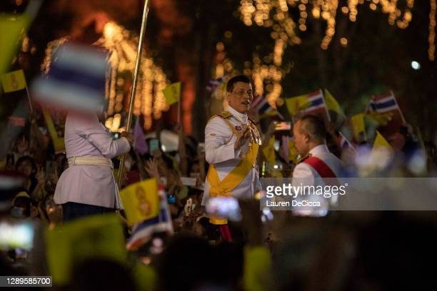 King Maha Vajiralongkorn greets his supporters as he visits Sanam Luang park for a candle-lit ceremony on December 05, 2020 in Bangkok, Thailand....