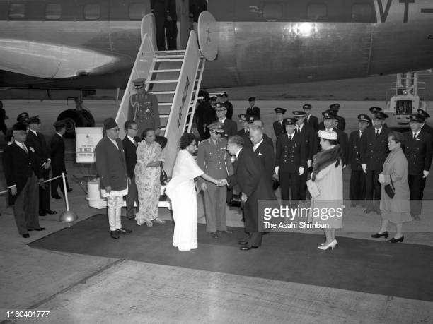 King Mahendra and Queen Ratna of Nepal are welcomed by Emperor Hirohito and Empress Nagako on arrival at Haneda Airport on April 18 1960 in Tokyo...