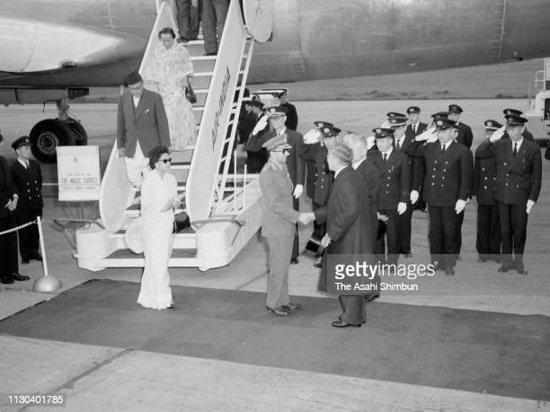 King Mahendra and Queen Ratna of Nepal are welcomed by Emperor Hirohito on arrival at Haneda Airport on April 18 1960 in Tokyo Japan