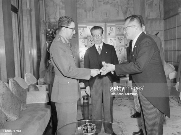 King Mahendra of Nepal is presented the 'key' of Tokyo by Tokyo Metropolitan Governor Ryotaro Azuma on April 19 1960 in Tokyo Japan