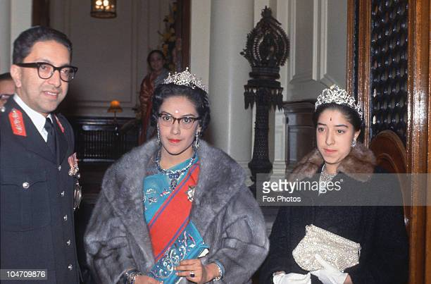 King Mahendra of Nepal with his wife Queen Ratna Rajya Laxmi Devi and one of his daughters at at reception held at the Nepalese Embassy in London...