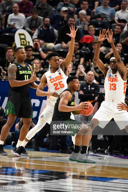 King McClure of the Baylor Bears attempts to drive on Tyus Battle and Paschal Chukwu of the Syracuse Orangeduring the game between the Syracuse...
