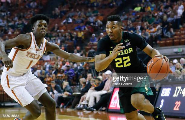 King McClure of the Baylor Bears drives around Andrew Jones of the Texas Longhorns at the Frank Erwin Center on March 4 2017 in Austin Texas